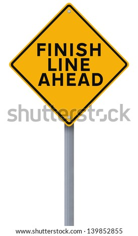 A road sign announcing the finish line coming up  - stock photo
