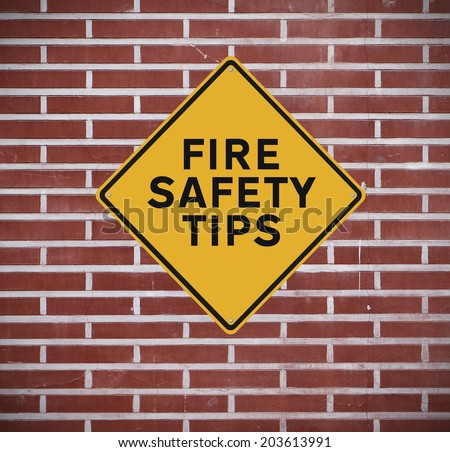A road sign indicating fire safety tips