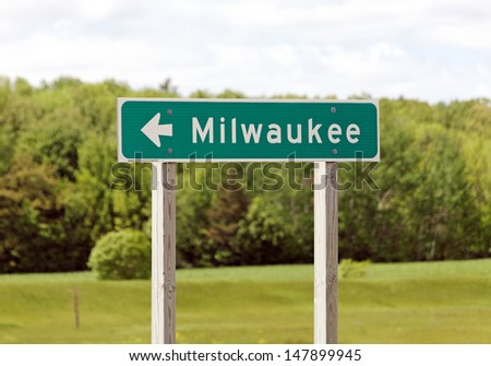 A road sign marking the way to Milwaukee, Wisconsin. - stock photo