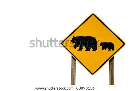 A road sign provides a warning about grizzly bears near the freeway. - stock photo