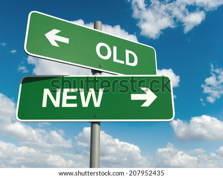 A road sign with old new words on sky background  - stock photo