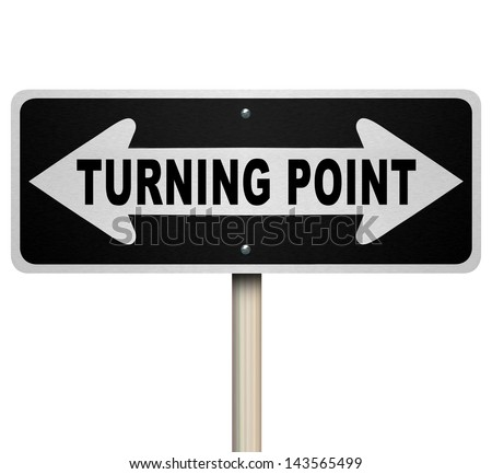 A road sign with the words Turning Point and arrows pointing left and right representing an important moment for you to make a major decision that will have big impact on your life or career - stock photo