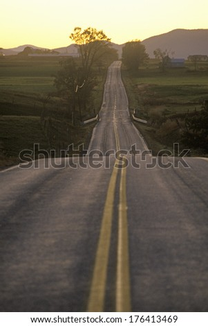 A road that goes from Adirondack Vermont to New York during sunset - stock photo