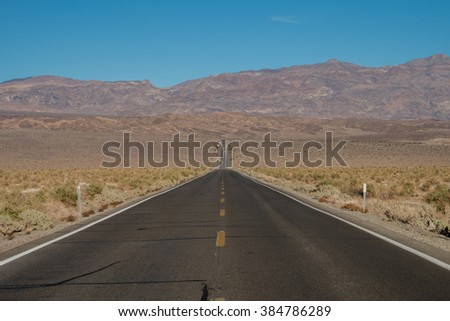 A road to Devil's Corn Field near Stovepipe Wells Village, Death Valley National Park - stock photo