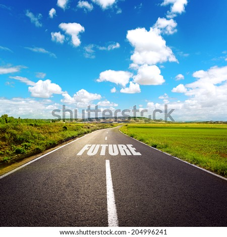 A road to future. Beautiful landscape of highway through meadow and white clouds. - stock photo