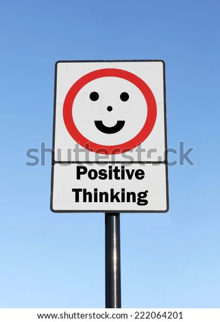 A road traffic sign with a positive thinking concept with a clear blue sky background. - stock photo