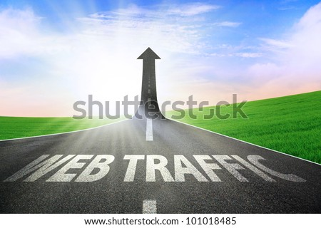 A road turning into an arrow rising upward symbolizing growth and improvement of web traffic - stock photo