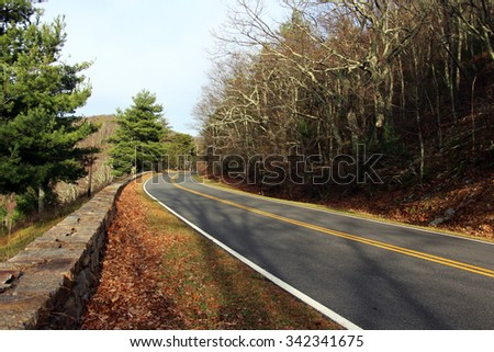A road winding through a fall forest. Shenandoah National Park, Virginia, United States - stock photo
