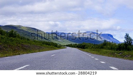 A road with mountains on a background