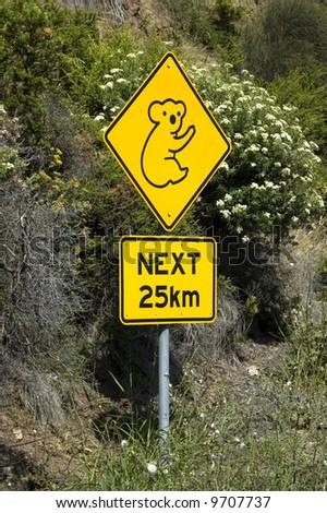 A roadside sign warns motorists of the presence of Koalas - stock photo
