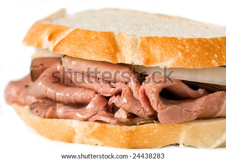 A Roast beef sandwich isolated on white