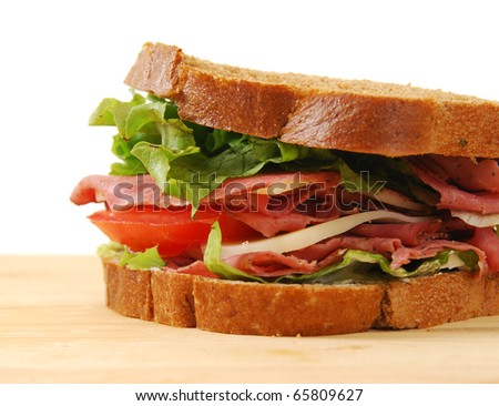 A roast beef sandwich on a cutting board - stock photo