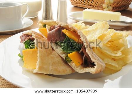 A roast beef sandwich on pita bread - stock photo