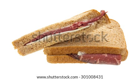 A roast beef sandwich with white cheese and mayonnaise isolated on a white background.