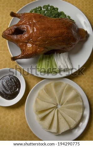 A roasted turkey served with two side dishes. - stock photo