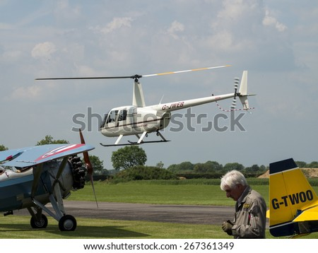 A robinson R22 pilot training helicopter at Breighton airfield,Yorkshire,UK.taken 14/07/2013 - stock photo