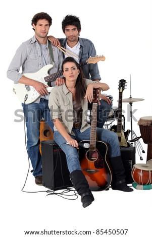 A rock band posing with their instruments - stock photo
