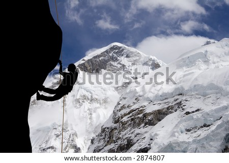 A rock climber near the west ridge of Mt. Everest - stock photo