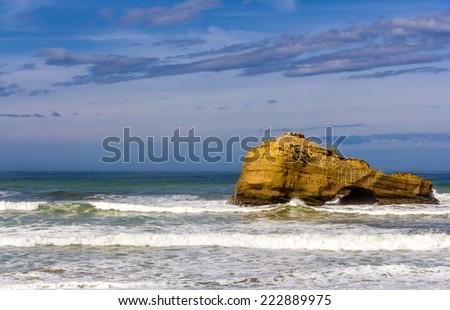 A rock in the Atlantic Ocean near Biarritz, France - stock photo