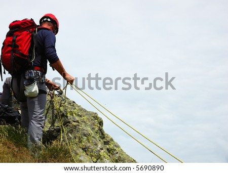 A rock / mountain climber at the end of his climb