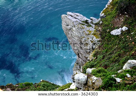 a rocky cliff near the cape of good hope in south africa - stock photo