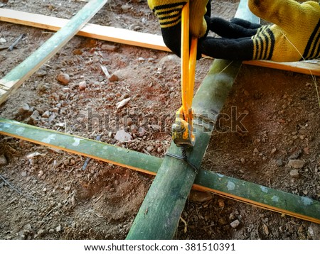 A rodbuster or bamboo laborer working on a reinforcing