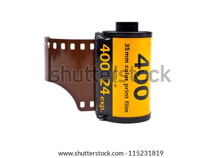 A roll of Photographic film on a white background. - stock photo