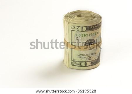 A roll of twenty dollar bills against a white background - stock photo
