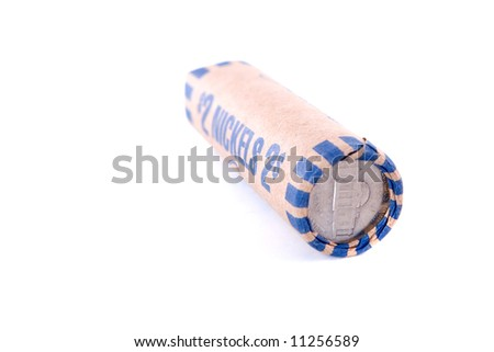 A roll of U.S. nickels isolated on white.