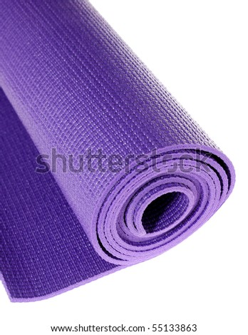a rolled up yoga or pilates exercise mat isolated on white. - stock photo