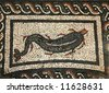 A Roman mosaic dolphin from Bignor Roman Villa Sussex England - stock photo