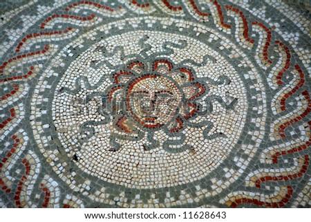 A Roman mosaic from Bignor Roman Villa Sussex England depicting Medusa the snake head Gorgon - stock photo