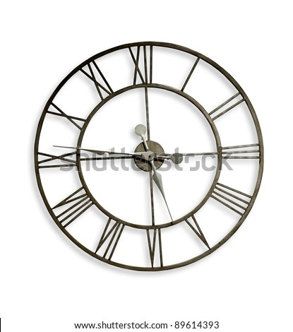 A Roman numeral metal wall clock. Clipping path included. - stock photo