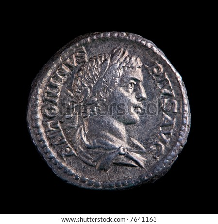 A Roman Silver Coin - Antoninus On A Black Background - stock photo
