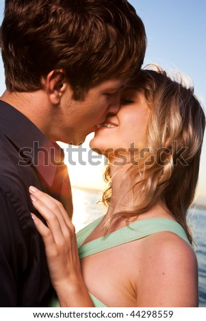 A romantic caucasian couple in love on the beach - stock photo
