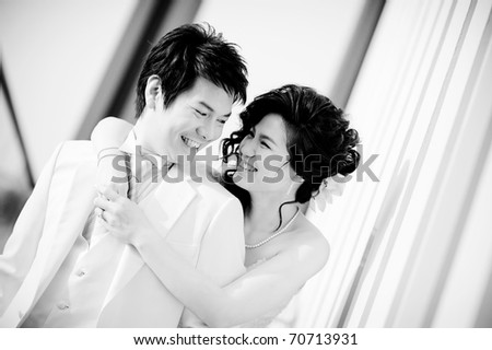a romantic couple in black and white mode - stock photo
