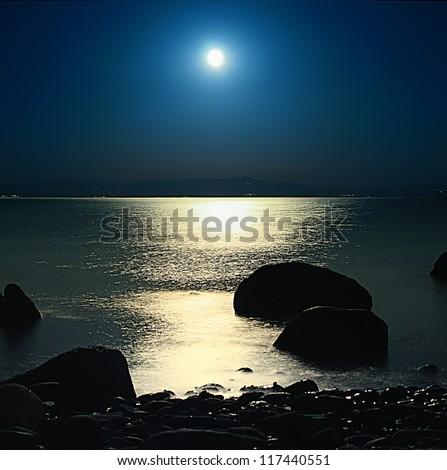 A romantic full moon rise at Assos, Turkey - stock photo