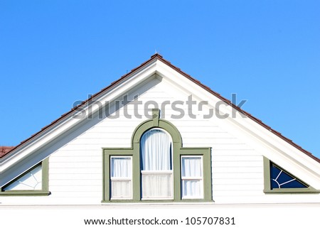 A roofline showing loft windows