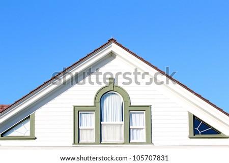 A roofline showing loft windows - stock photo