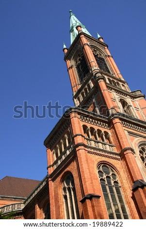 A rose brick church in Dusseldorf (Germany) - stock photo