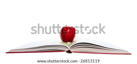 A rosy, red apple on a school atlas.  Shot on white background.