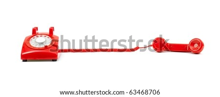 A rotary telephone isolated against a white background - stock photo