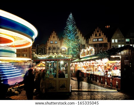 A rotating Merry-go-round at The Christmas Market of Frankfurt, German, Europe - stock photo