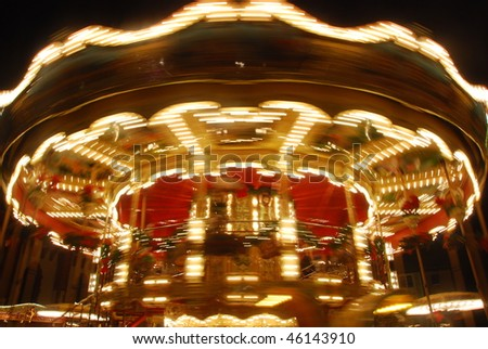 "A rotating Merry-go-round at the famous ""Weihnachtsmarkt"" (The Christmas Market) of Frankfurt, German, Europe - stock photo"