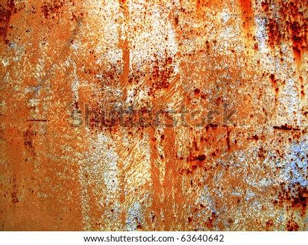 A rotted metal panel covered in rust - stock photo