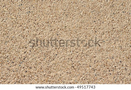 A rough pebble concrete footpath or sidewalk background - stock photo