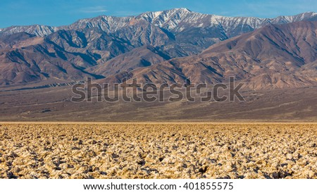 A rough texture from the large salt crystal formations. A large salt pan on the floor of Death Valley. Devil's Golf Course, Death Valley National Park - stock photo