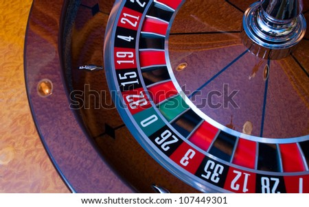 A roulette wheel at the casino.