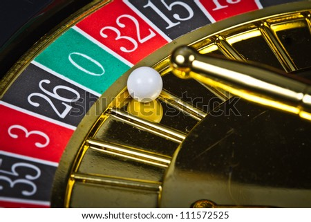 A roulette with the ball in 0 - stock photo