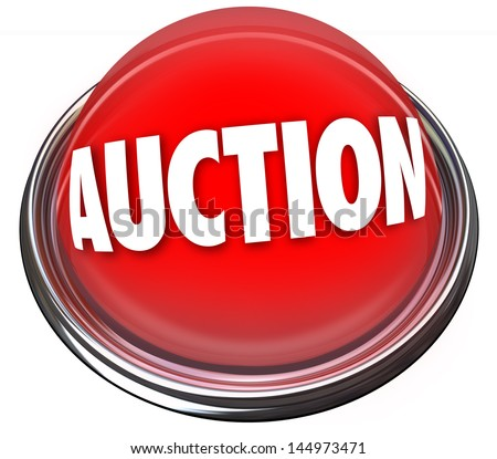 A round red button in metal and light reading Auction to advertise an item for sale to the highest bidder - stock photo